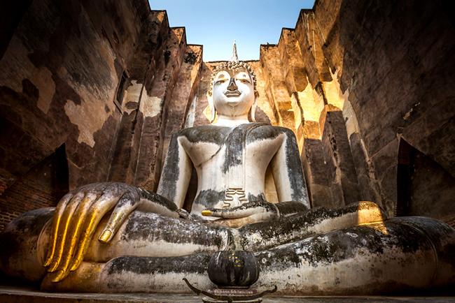 Ancient buddha statue. Sukhothai Historical Park,